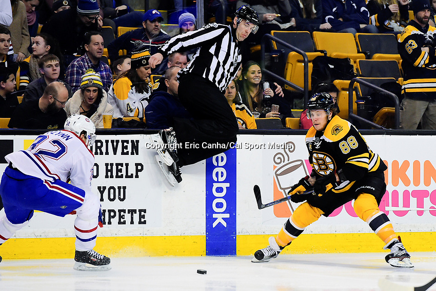 February 12, 2017: Boston Bruins right wing David Pastrnak (88) and Montreal Canadiens center Brian Flynn (32) race to the puck as linesman Brian Mach (78) leaps out of the way during the National Hockey League game between the Montreal Canadiens and the Boston Bruins held at TD Garden, in Boston, Mass. Boston defeats Montreal 4-0. Eric Canha/CSM