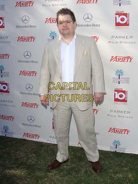 Patton Oswalt.The 23rd Variety's Indie Impact Award & 10 Directors To Watch Brunch Presented By Mercedes-Benz Held At Parker Resorts Palm Springs, Palm Springs, California, USA..January 8th, 2012.full length white shirt beige suit pinstripe glasses .CAP/ADM/KB.©Kevan Brooks/AdMedia/Capital Pictures.