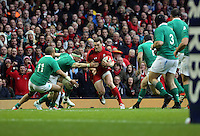 Pictured: George North of Wales (C) tries to avoid a tackle Saturday 14 March 2015<br />