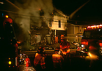 Firefighters battle a house fire.