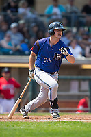 Gavin Stupienski (34) of the Missoula Osprey follows through on his swing against the Billings Mustangs at Dehler Park on August 20, 2017 in Billings, Montana.  The Osprey defeated the Mustangs 6-4.  (Brian Westerholt/Four Seam Images)