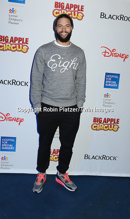 Deron Williams from the Brooklyn Nets  attends the Hospital for Special Surgery's 8th Annual  Big Apple Circus Benefit on December 6, 2014 at Damrosch Park in Lincoln Center  in New York City, USA.<br /> <br /> photo by Robin Platzer/Twin Images<br />  <br /> phone number 212-935-0770