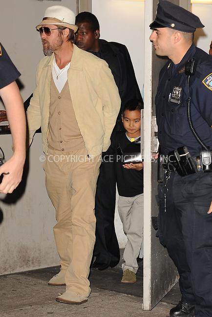 WWW.ACEPIXS.COM . . . . . .September 25, 2009, New York City....Actor Brad Pitt AND Maddox Jolie-Pitt at Dave and Buster's September 25, 2009 in New York City....Please byline: KRISTIN CALLAHAN - ACEPIXS.COM.. . . . . . ..Ace Pictures, Inc: ..tel: (212) 243 8787 or (646) 769 0430..e-mail: info@acepixs.com..web: http://www.acepixs.com .