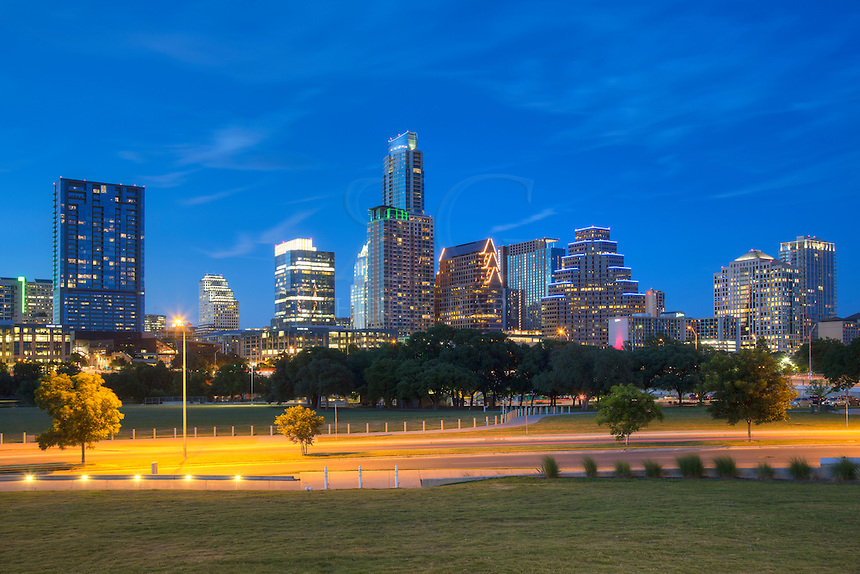 Summertime in Austin, Texas, can be hot, but in the evening Zilker Park and Ladybird Lake is a great place to spend some time. In the shadow of the Austin highrises, you'll have the best of both worlds - outdoors recreation with a great skyline view.
