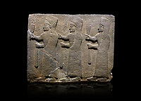 Hittite monumental relief sculpted orthostat stone panel of a Procession. Basalt, Karkamıs, (Kargamıs), Carchemish (Karkemish), 900-700 B.C.  Marching female figures. Anatolian Civilisations Museum, Ankara, Turkey.<br /> <br /> It is a depiction of three marching female figures in long dress with a high headdress at their head. These women are considered to be the nuns of the Goddess Kubaba. They have a bunch of Spica in their right hand, and objects similar to a sceptre in their left hand. <br /> <br /> Against a black background.