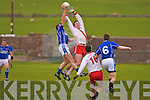 Darragh O'Shea (Gaeltacht) feeling the ball with Maurice Foley (Lrgs) behind.