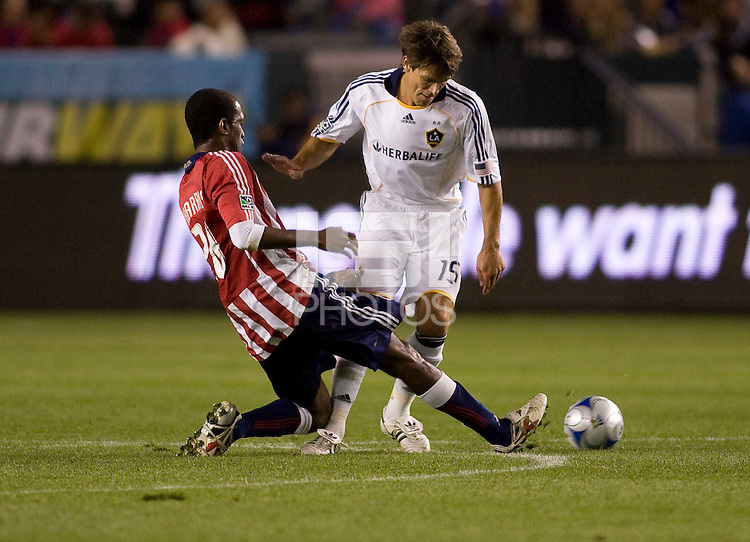 Chivas USA's Atiba Harris steals a ball away from LA Galaxy's Stefani Miglioranzi. Chivas USA and the LA Galaxy played to a 0-0 draw at Home Depot Center stadium in Carson, California on Saturday April 11, 2009.  .