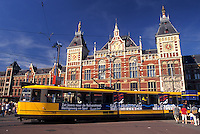 Amsterdam, Netherlands, Central Station, Holland, Noord-Holland, Europe, Yellow tram outside Centraal Station (CS) in the city of Amsterdam.