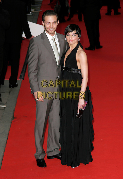 MATT DI ANGEO & FLAVIA CACACE.Red Carpet Arrivals for the British Academy Television Awards 2008, held at the London Palladium, London, England, .April 20th 2008. .BAFTA BAFTA's full length grey gray suit black halterneck dress .CAP/AH.©Adam Houghton/Capital Pictures.