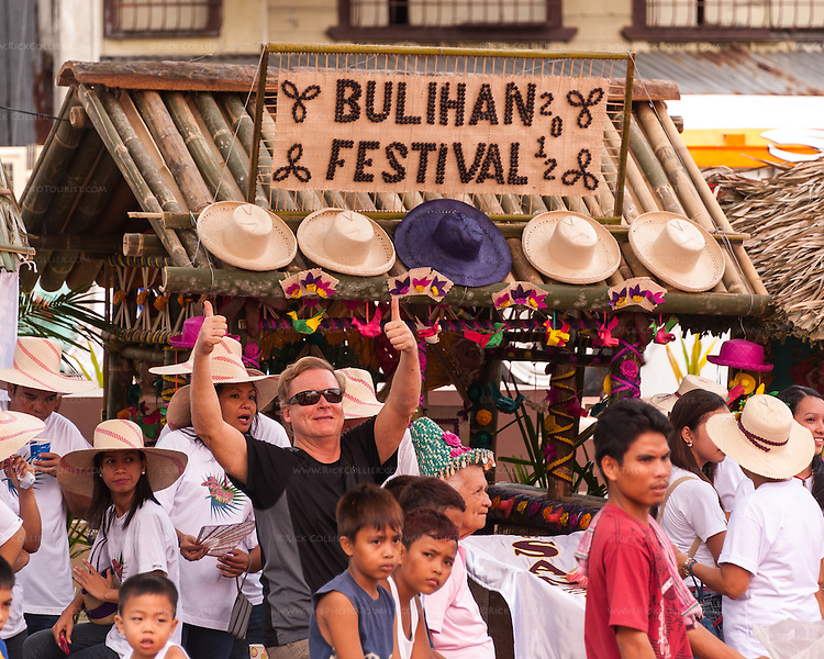 The Buri Bag Project's own Mr. Mark Bauer welcomes photographer Rick Collier to Sampaloc, in the municipal plaza that is the center of the annual Bulihan Fiesta.  (Sampaloc, Quezon Province, the Philippines.)