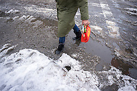 Pedestrians slog through puddles of slush and snow at street crossings with snow dam clogged storm drains in the Chelsea neighborhood of New York on Monday, February 2,. 2015. New Yorkers on the way to work faced it all, freezing rain, snow and plain rain as a storm passes through the city. Temperatures are expected to drop and with more precipitation the existing slush and standing water will turn to dangerous ice.  (© Richard B. Levine)