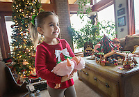 STAFF PHOTO JASON IVESTER --12/17/2014--<br /> Kinley (cq) Rollins, 2, plays with a doll on Wednesday, Dec. 17, 2014, in the living room of her grandparents' Springdale home.