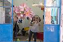 Visitors take picture with her smartphone of the pink daidy at Fuorisalone 2016 in Ventura street, Milan, April 14, 2016. &copy; Carlo Cerchioli<br /> <br /> Visitatrice fa una fotografia con il smartphone alle margherite rosa al Fuorisalone 2016 nell'area di via Ventura, Milano 14 aprile, 2016.