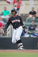 Louis Silverio (25) of the Kannapolis Intimidators follows through on his swing against the West Virginia Power at Intimidators Stadium on July 3, 2015 in Kannapolis, North Carolina.  The Intimidators defeated the Power 3-0 in a game called in the bottom of the 7th inning due to rain.  (Brian Westerholt/Four Seam Images)