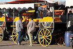A vendor sells fresh orange juice in the Place DJemaa El-Fna in Marrakesh, Morocco.