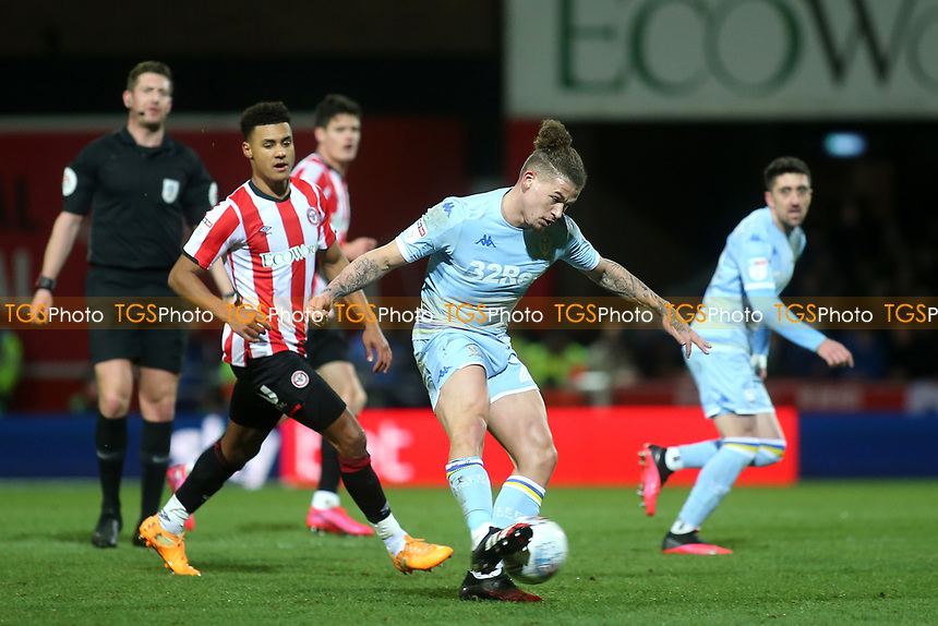 Kalvin Phillips of Leeds United in action as Brentford's Ollie Watkins looks on during Brentford vs Leeds United, Sky Bet EFL Championship Football at Griffin Park on 11th February 2020