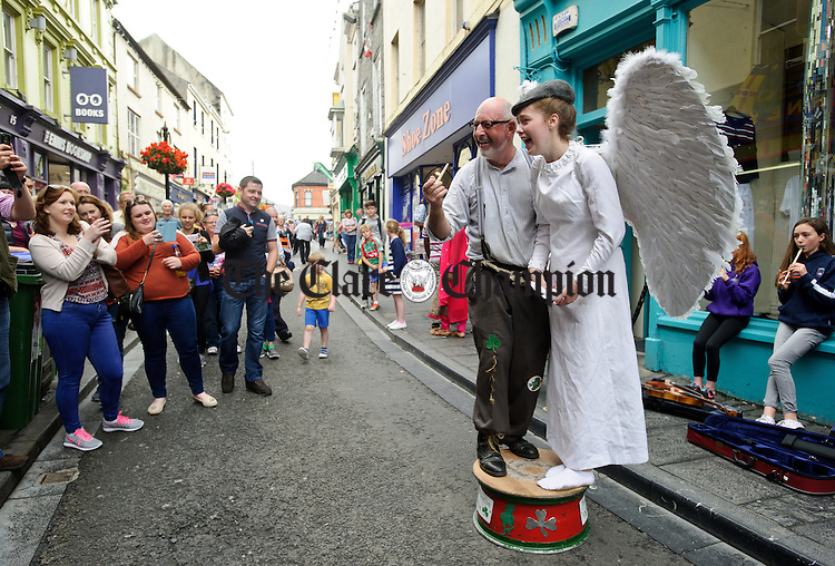 """Heavens Above....Street performer Kevin Cuniffe of Ballinasloe is joined by """"Angel"""" Neidin Mooney of Ennis for a performance during Fleadh Cheoil na hEireann in Ennis. Photograph by John Kelly."""