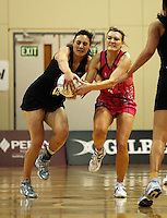 NZ goal defence Joline Henry takes a pass under pressure from Natasha Chokljat during the International  Netball Series match between the NZ Silver Ferns and World 7 at TSB Bank Arena, Wellington, New Zealand on Monday, 24 August 2009. Photo: Dave Lintott / lintottphoto.co.nz