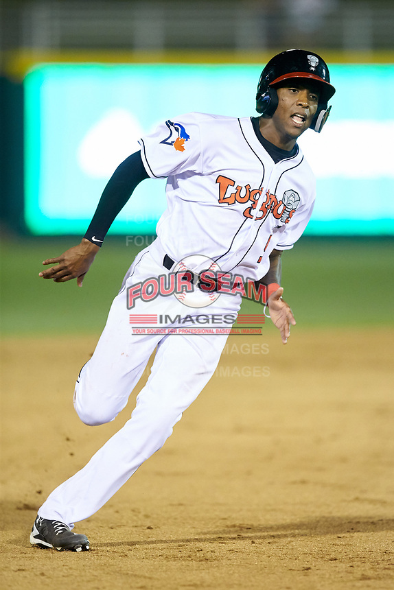 Reggie Pruitt (5) of the Lansing Lugnuts hustles towards third base against the South Bend Cubs at Cooley Law School Stadium on June 15, 2018 in Lansing, Michigan. The Lugnuts defeated the Cubs 6-4.  (Brian Westerholt/Four Seam Images)