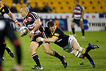 Jimmy Gopperth tackles Tanner Vili. Air New Zealand Cup rugby game between Counties Manukau Steelers & Wellington played at Mt Smart Stadium on the 31st August 2007. The Score was 13 all at halftime, with Wellington going on to win 33 - 18.
