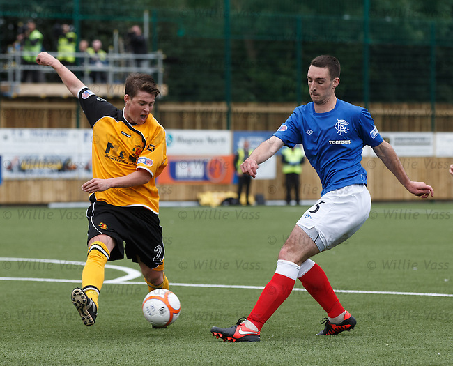 Lee Wallace strides forwards and has a dig
