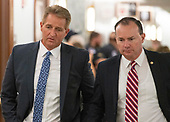 United States Senator Jeff Flake (Republican of Arizona) and US Senator Mike Lee (Republican of Utah) in conversation as they walk in the hallway during a break in the testimony of Dr. Christine Blasey Ford  before the US Senate Committee on the Judiciary on the nomination of Judge Brett Kavanaugh to be Associate Justice of the US Supreme Court to replace the retiring Justice Anthony Kennedy on Capitol Hill in Washington, DC on Thursday, September 27, 2018.   <br /> Credit: Ron Sachs / CNP<br /> (RESTRICTION: NO New York or New Jersey Newspapers or newspapers within a 75 mile radius of New York City)