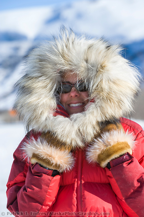 Woman in fur ruff parka