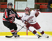 Casie Fields (NU - 9), Katharine Chute (Harvard - 15) - The Harvard University Crimson defeated the Northeastern University Huskies 1-0 to win the 2010 Beanpot on Tuesday, February 9, 2010, at the Bright Hockey Center in Cambridge, Massachusetts.
