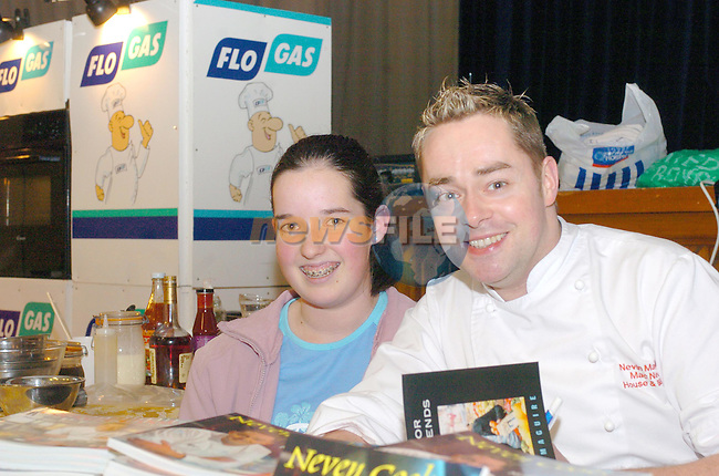 Aoife Walsh with Nevin Maguire at the Flo Gas Cookery demo in aid of the MMM in the MMM Auditorium..Photo Fran Caffrey Newsfile.ie..This Picture has been sent to you by Newsfile Ltd..The Studio,.Millmount Abbey,.Drogheda,.Co. Meath,.Ireland..Tel: +353(0)41-9871240.Fax: +353(0)41-9871260.ISDN: +353(0)41-9871010.www.newsfile.ie..general email: pictures@newsfile.ie