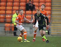 Bristol Rovers' Rory Gaffney and Blackpool's Oliver Turton (left) <br /> <br /> Photographer Stephen White/CameraSport<br /> <br /> The EFL Sky Bet League One - Blackpool v Bristol Rovers - Saturday 13th January 2018 - Bloomfield Road - Blackpool<br /> <br /> World Copyright &copy; 2018 CameraSport. All rights reserved. 43 Linden Ave. Countesthorpe. Leicester. England. LE8 5PG - Tel: +44 (0) 116 277 4147 - admin@camerasport.com - www.camerasport.com