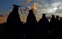 The students of Western Albemarle High School were silhouetted under a beautiful setting sun as they made there ways to their seats during the graduation ceremonies held Friday at Western Albemarle High School. Photo/The Daily Progress/Andrew Shurtleff