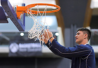 Shalom Broughton snips the net after St Kentigern won the 2019 Schick AA Boys' Secondary Schools Basketball National Championship final between St Kentigern and Rosmini College at the Central Energy Trust Arena in Palmerston North, New Zealand on Saturday, 5 October 2019. Photo: Dave Lintott / lintottphoto.co.nz
