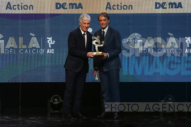 Gian Piero Gasperini Head coach of the Year 2019 receives his award from Roberto Mancini at the The Italian Footballers Association Grand Gala of Football at the Megawatt Court, Milan. Picture date: 2nd December 2019. Picture credit should read: Jonathan Moscrop/Sportimage