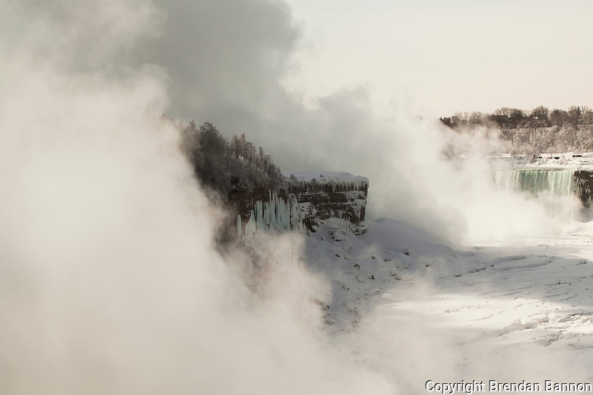 The Horsehoe falls on the Canadian side in view on the right. The American side of the falls is obscured in a shifting cloud of freezing mist at Prospect Point. Niagara Falls from the American side. Brendan Bannon.