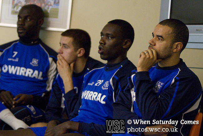 Rochdale v Tranmere Rovers preparations, 31/12/2010. Prenton Park, League One. Tranmere Rovers players (l to r) Enoch Showunmi, Dale Jennings, Germaine Grandison and Marlon Broomes watching and listening to coach David Low's briefing the first team squad at the club's Prenton Park ground, as the club prepare for the following day's Npower League 1 fixture away to Rochdale. It was the first league fixture between the teams since March 1989. Rochdale won this latest encounter by three goals to two watched by a crowd of 5,500. Photo by Colin McPherson.