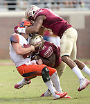 Florida State's linebacker Jacob Pugh, top, and Derrick Nnadi sack Syracuse quarterback Eric Dungey on the final drive on the final drive in the second half of an NCAA college football game in Tallahassee, Fla., Saturday, Nov. 4, 2017. Florida State defeated Syracuse 27-24. (AP Photo/Mark Wallheiser)