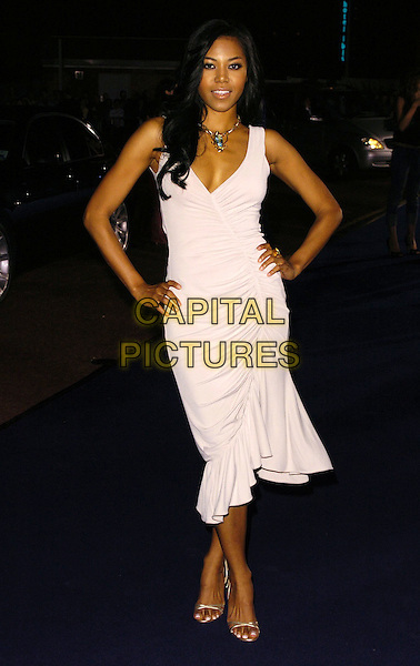 AMERIE.At the Giorgio Armani RED One Night Only .Fashion & Music Party, Earls Court, .London, England, September 21st 2006..full length white dress hands on hips.Ref: CAN.www.capitalpictures.com.sales@capitalpictures.com.©Can Nguyen/Capital Pictures