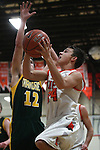 Jaden Wass, of Douglas, shoots past Manogues' Jack Sanders in the varsity basketball game at DHS on Tuesday, Jan. 15, 2013. Douglas won 68-49..Photo by Cathleen Allison