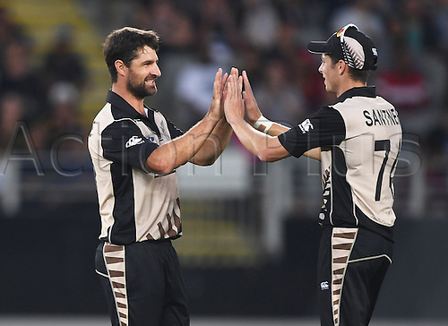 February 17th 2017,  Colin de Grandhomme celebrates with Mitchell Santner the wicket of du Plessis. International Twenty20 Cricket. New Zealand Black Caps v South Africa, Eden Park, Auckland, New Zealand. Friday 17 February 2017
