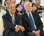 Felix Fraga, left, and John Marshall, right, listen to comments during The Rusk School ribbon cutting ceremony, April 7, 2014.