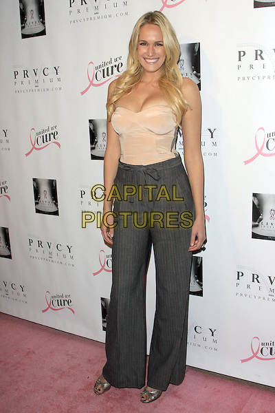 ASHLAN GORSE .PRVCY Premium Denim Book and CD Launch Party held At Beso, Hollywood, California, USA..December 8th, 2009.full length grey gray high waisted trousers wide leg flared beige cream top pinstripe .CAP/ADM/KB.©Kevan Brooks/AdMedia/Capital Pictures.