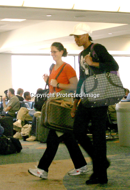 **EXCLUSIVE**<br />Venus Williams travels with a female friend from Ft. Lauderdale to Los Angeles on American Airlines, in this photo she is at Ft. Lauderdale Airport<br />Ft. Lauderdale, FL, USA<br />Monday, November 08, 2004<br />Photo By Celebrityvibe.com/Photovibe.com, New York, USA, Phone 212 410 5354, email:sales@celebrityvibe.com