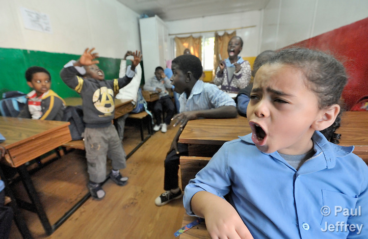 Refugee children in class in a school operated by St. Andrew's Refugee Services in Cairo, Egypt. The school is supported by Church World Service.