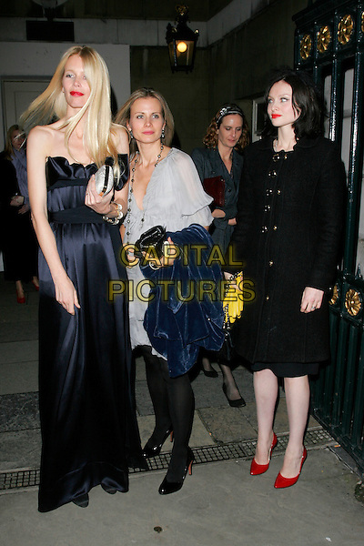 CLAUDIA SCHIFFER & SOPHIE ELLIS BEXTOR .Leaving Chaos Point, in aid of NSPCC  at the Banqueting House, London, England..November 18th, 2008 .full length black blue long strapless dress silver clutch bag red shoes coat jacket.CAP/AH.©Adam Houghton/Capital Pictures.