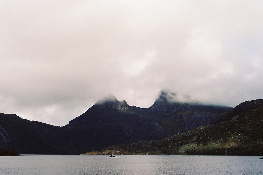 Tasmania's Cradle Mountain in cloud across Dove Lake, from the Overland Track, Cradle Mountain Lake St Clair National Park, Tasmania, Australia.
