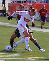 Yura Movsisyan #14  of Real Salt Lake and  Chris Rolfe #17 of the Chicago Fire. The Chicago Fire and Real Salt Lake played to a 1-1 tie during a Major League Soccer match at Rice-Eccles Stadium in Salt Lake City, Utah on March 29, 2008.