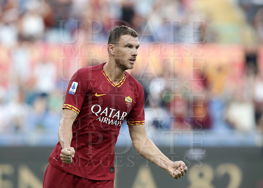 Football, Serie A: AS Roma - Sassuolo, Olympic stadium, Rome, September 15, 2019. <br /> Roma's Edin Dzeko celebrates after scoring during the Italian Serie A football match between Roma and Sassuolo at Olympic stadium in Rome, on September 15, 2019.<br /> UPDATE IMAGES PRESS/Isabella Bonotto