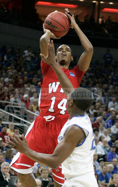 Jamal Crook shots against the University of Kentucky during the second round of the NCAA Tournament, in the KFC Yum! Center, on Thursday, March 15, 2012 in Louisville, Ky.  Photo by Latara Appleby | Staff ..