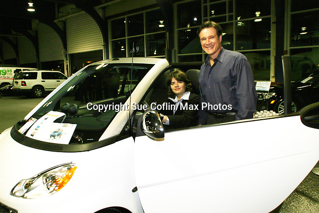 Frank Dicopoulos and family - wife Teja - son Jaden and daughter Olivia pose with Smart Car at the 16th Annual Feast with Famous Faces to benefit the League for the Hard of Hearing on October 27, 2008 at Pier Sixty at Chelsea Piers, New York City, New York. (Photo by Sue Coflin/Max Photos)