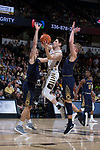 Britton Anderson (52) of the Wake Forest Demon Deacons drives to the basket past John Mooney (33) and Rex Pflueger (0) of the Notre Dame Fighting Irish during first half action at the LJVM Coliseum on February 24, 2018 in Winston-Salem, North Carolina.  The Fighting Irish defeated the Demon Deacons 76-71.  (Brian Westerholt/Sports On Film)